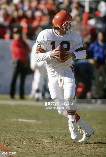 Bernie Kosar of the Cleveland Browns looks to throw a pass against the Denver Broncos during an NFL Football game circa 1990 at Mile High Stadium in...