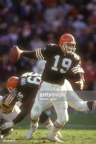Bernie Kosar of the Cleveland Browns looks to throw the ball during a football game against the Washington Redskins on October 13 1991 at RFK Stadium...