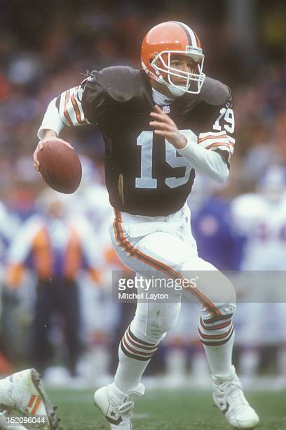 Bernie Kosar of the Cleveland Browns runs with the ball during a football game against the Houston Oilers on November 21 1993 at Cleveland Municipal...