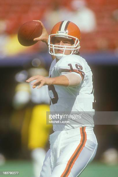 Bernie Kosar of the Cleveland Browns warms up before a football game against the Pittsburgh Steelers on October 15 1986 at Three Rivers Stadium in...