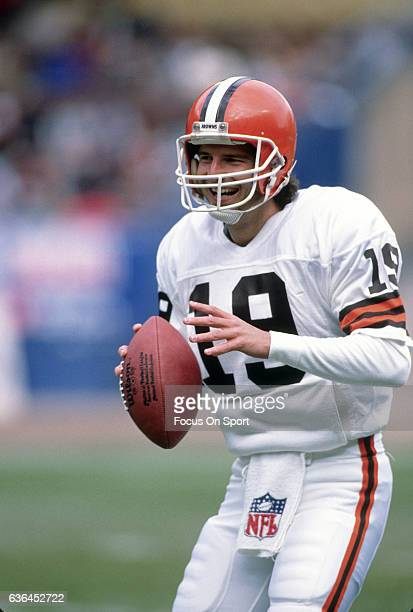 Bernie Kosar of the Cleveland Browns warms up during pregame warm ups prior to playing the Denver Broncos in an NFL Football game circa 1989 at Mile...