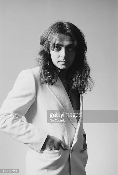 Bernie Marsden guitarist with British rock band Whitesnake wearing a light jacket and posing for studio portrait in Camden London England Great...