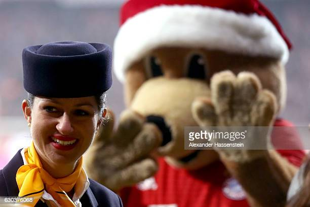 Bernie mascot of Muenchen stand next to Lufthansa air hostesse at the half time show during the Bundesliga match between Bayern Muenchen and RB...