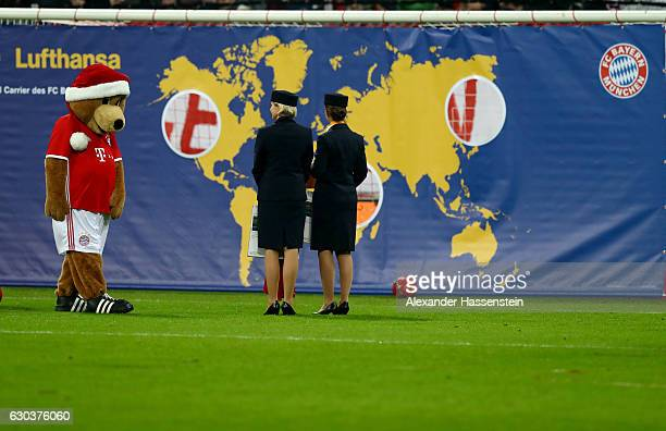 Bernie mascot of Muenchen stand next to Lufthansa air hostesses at the half time show during the Bundesliga match between Bayern Muenchen and RB...