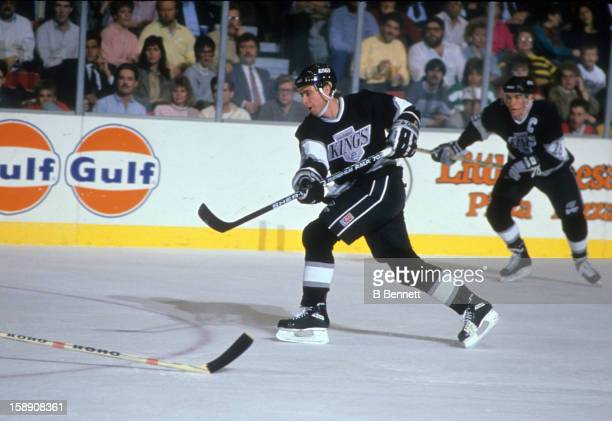 Bernie Nicholls of the Los Angeles Kings shoots during an NHL game against the New York Islanders on December 10, 1988 at the Nassau Coliseum in...