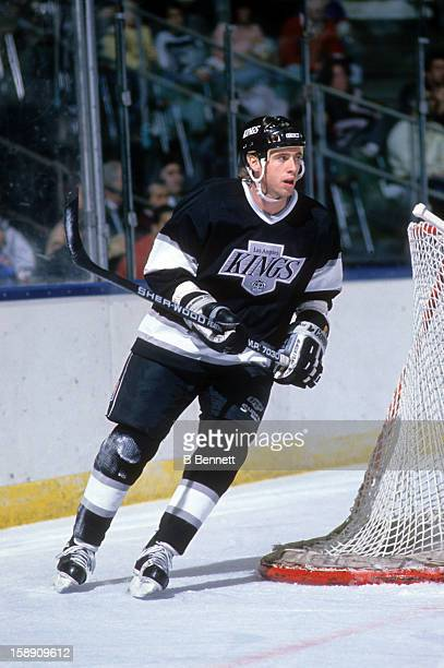 Bernie Nicholls of the Los Angeles Kings skates on the ice during an NHL game against the New York Islanders on December 10, 1988 at the Nassau...