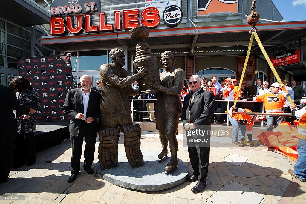 Bernie Parent and Bob Clarke attend the Comcast-Spectacor unveiling of a new seven-foot tall bronze statue of then team captain Bob Clarke and goaltender Bernie Parent hoisting the Stanley Cup commemorating one of the most iconic moments in Philadelphia Flyers history at Xfinity Live March 30, 2013 in Philadelphia, Pennsylvania.