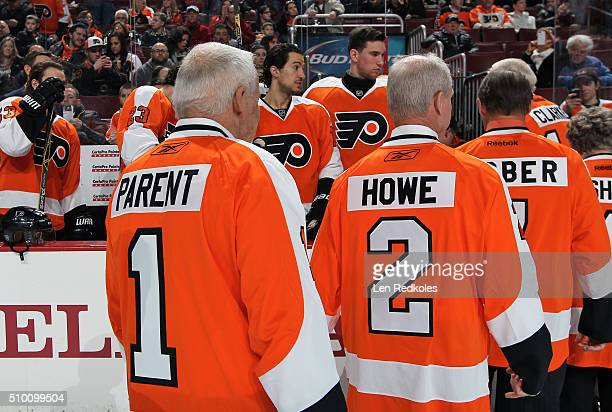 Bernie Parent Mark Howe Bill Barber Donna Ashbee and Bob Clarke walk off ice following a pregame ceremony to unveil the new 50th anniversary logo...