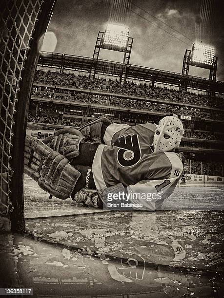 Bernie Parent of the Philadelphia Flyers makes a save during the alumni game at Citizens Bank Park in Philadelphia, PA on December 31, 2011.
