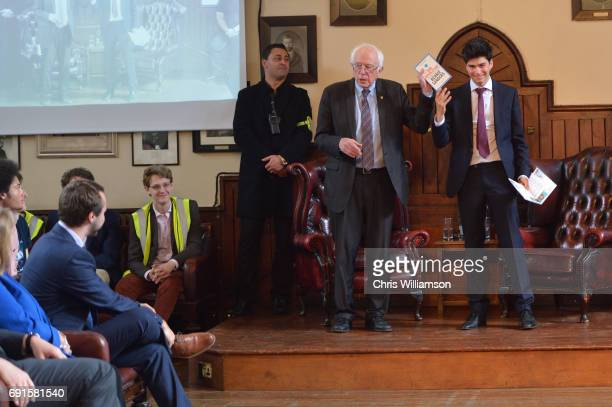 Bernie Sanders holds up a book as he prepares to speak at The Cambridge Union on June 2 2017 in Cambridge England The former US presidential...