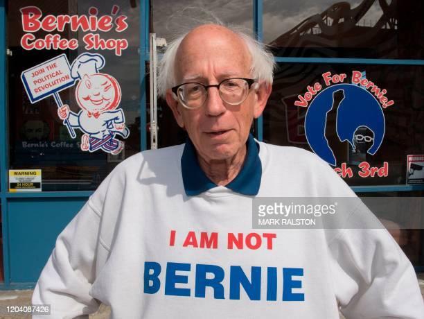 "Bernie Sanders lookalike Jeff Jones wears his ""I am not Bernie"" sweater outside the candidate's campaign headquarters in Los Angeles, California on..."