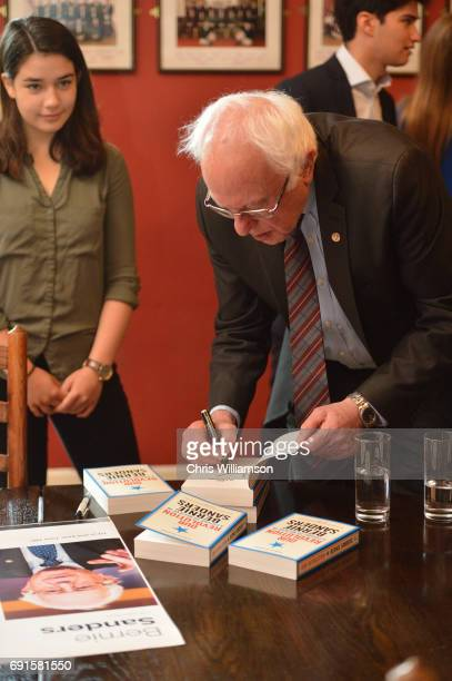 Bernie Sanders signs books at The Cambridge Union on June 2 2017 in Cambridge England The former US presidential candidate gave a speech at the...