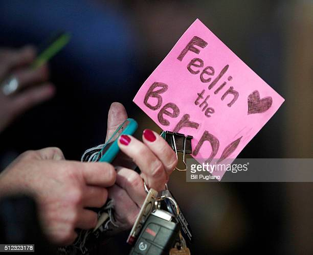 Bernie Sanders supporter holds a small sign while waiting for US Senator and Democratic presidential candidate Bernie Sanders to speak at a community...