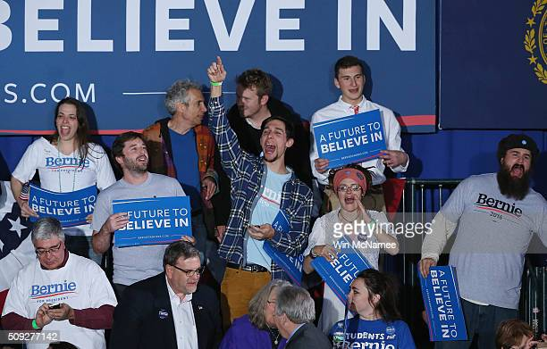 Bernie Sanders supporters cheer waiting for the candidate to come out at the candidate's New Hampshire Primary Night watch party February 9 2016 in...