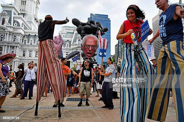 Bernie Sanders supporters gather near City Hall on day three of the Democratic National Convention on July 27 2016 in Philadelphia Pennsylvania The...