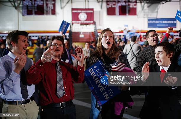 Bernie Sanders supporters react to television predictions of Sanders winning the Democratic New Hampshire Primary at the candidate's New Hampshire...