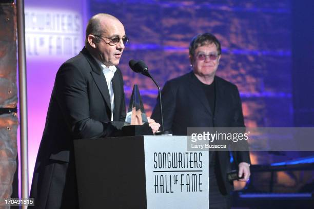 Bernie Taupin and Elton John accept the Mercer Award at the Songwriters Hall of Fame 44th Annual Induction and Awards Dinner at the New York Marriott...