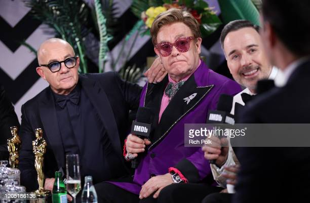 Bernie Taupin, Elton John and David Furnish speak on stage at IMDb LIVE Presented By M&M'S At The Elton John AIDS Foundation Academy Awards Viewing...