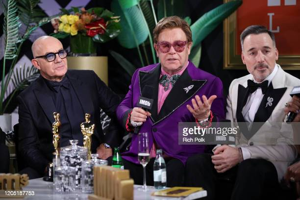 Bernie Taupin Elton John and David Furnish speak on stage at IMDb LIVE Presented By MM'S At The Elton John AIDS Foundation Academy Awards Viewing...