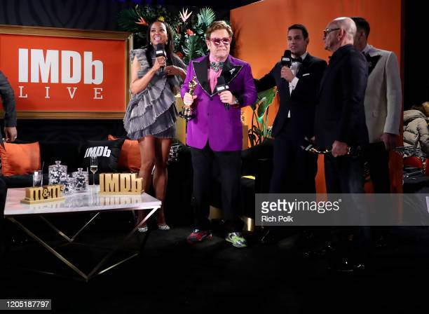 Bernie Taupin Elton John and David Furnish speak on stage IMDb LIVE Presented By MM'S At The Elton John AIDS Foundation Academy Awards Viewing Party...