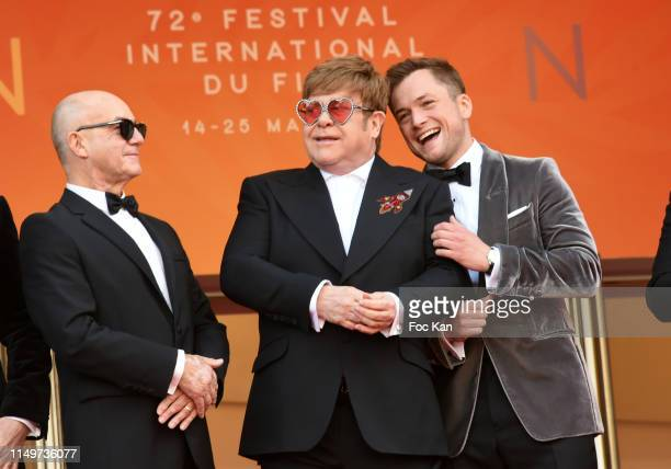 Bernie Taupin Sir Elton John and Taron Egerton attend the screening of Rocketman during the 72nd annual Cannes Film Festival on May 16 2019 in Cannes...