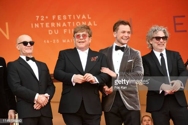 Bernie Taupin Sir Elton John Taron Egerton and Director Dexter Fletcher attend the screening of Rocketman during the 72nd annual Cannes Film Festival...