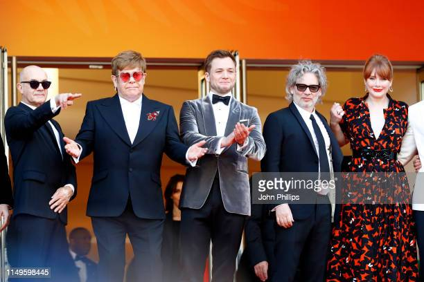 Bernie Taupin Sir Elton John Taron Egerton Director Dexter Fletcher and Bryce Dallas Howard attend the screening of Rocketman during the 72nd annual...