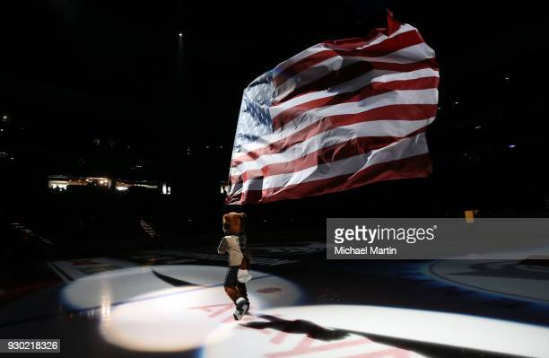 Bernie the mascot of the Colorado Avalanche skates with the American Flag prior to the game against the Arizona Coyotes at the Pepsi Center on March...