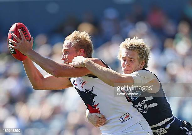 Bernie Vince of the Crows is tackled by Cameron Guthrie of the Cats during the round two AFL NAB Cup match between the Geelong Cats and the Adelaide...