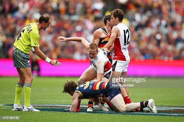 Bernie Vince of the Demons and Patrick Dangerfield of the Crows wrestle on the ground during the round three AFL match between the Adelaide Crows and...