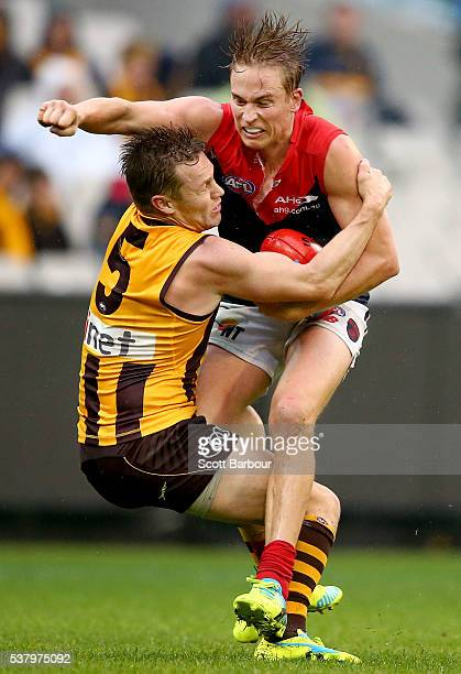 Bernie Vince of the Demons and Sam Mitchell of the Hawks compete for the ball during the round 11 AFL match between the Hawthorn Hawks and Melbourne...