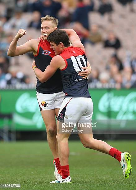 Bernie Vince of the Demons is congratulated by Angus Brayshaw after kicking a goal during the round 18 AFL match between the Collingwood Magpies and...