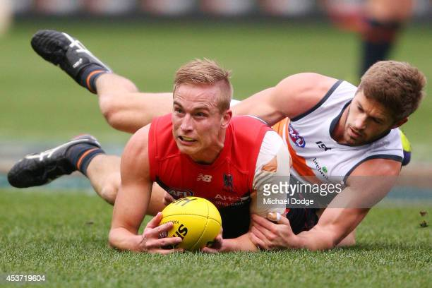 Bernie Vince of the Demons is tackled by Callan Ward of the Giants during the round 21 AFL match between the Melbourne Demons and the Greater Western...