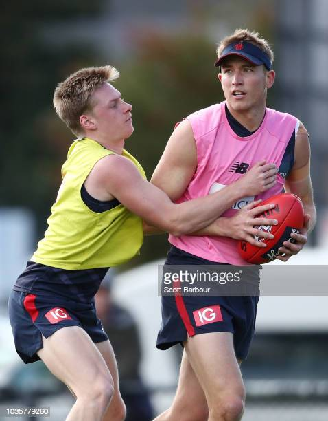 Bernie Vince of the Demons is tackled by Charlie Spargo of the Demons during a Melbourne Demons AFL training session at Gosch's Paddock on September...
