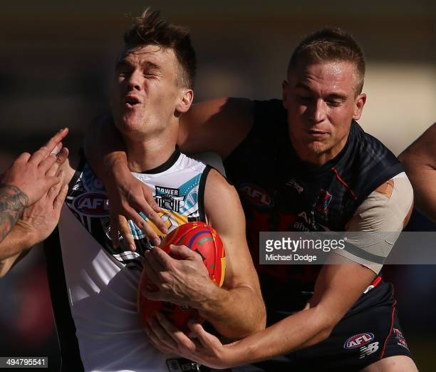 Bernie Vince of the Demons tackled Robbie Gray of the Power during the round 11 AFL match between the Melbourne Demons and the Port Power at Traeger...