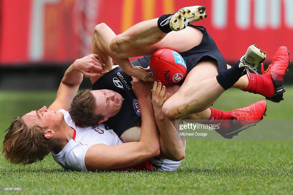 Bernie Vince of the Demons tackles Liam Sumner of the Blues during the round 22 AFL match between the Carlton Blues and the Melbourne Demons at Melbourne Cricket Ground on August 21, 2016 in Melbourne, Australia.
