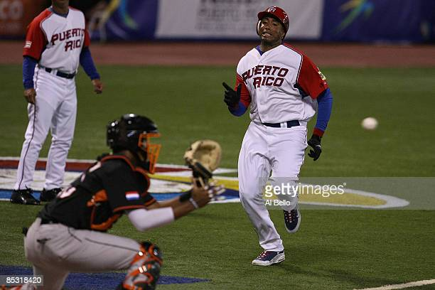 Bernie Williams of Puerto Rico is tagged out at the plate by Kenley Jansen of The Netherlands during the 2009 World Baseball Classic Pool D match on...