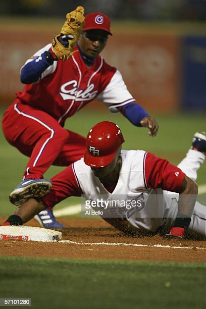 Bernie Williams of Puerto Rico is tagged out by Ariel Borrero of Cuba in the third inning of their game during Round 2 of the World Baseball Classic...