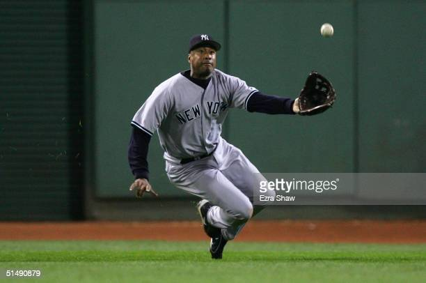 Bernie Williams of the New York Yankees catches a linedrive by Orlando Cabrera of the Boston Red Sox in the seventh inning during game four of the...