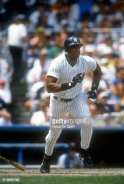 Bernie Williams of the New York Yankees puts the ball in play and runs out of the batters box during a Major League Baseball game circa 1996 at...