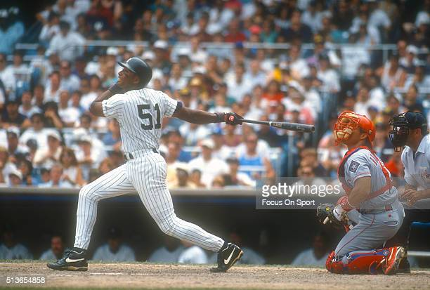 Bernie Williams of the New York Yankees swings and watches the flight of his ball against the Texas Rangers during a Major League Baseball game circa...