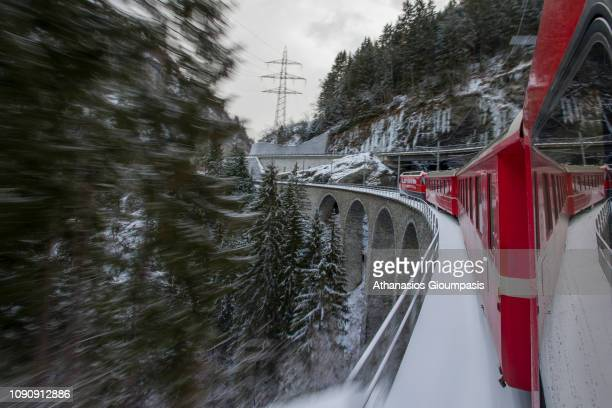 Bernina Express at Landwasser Viaduct at the Swiss Alps on January 02 2019 in St Moritz Switzerland The Rhaetian Railway of Albula/Bernina...