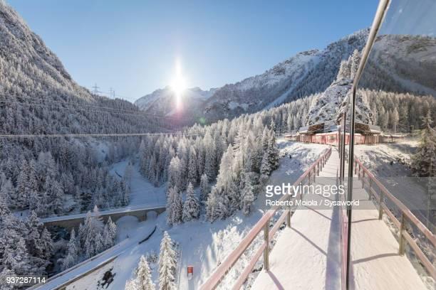 bernina express train, albula valley, switzerland - kanton graubünden stock-fotos und bilder