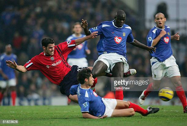 Bernt Haas of WBA is fouled by Dejan Stefanovic and Amdy Faye of Portsmouth during the Barclays Premiership match between Portsmouth and West...