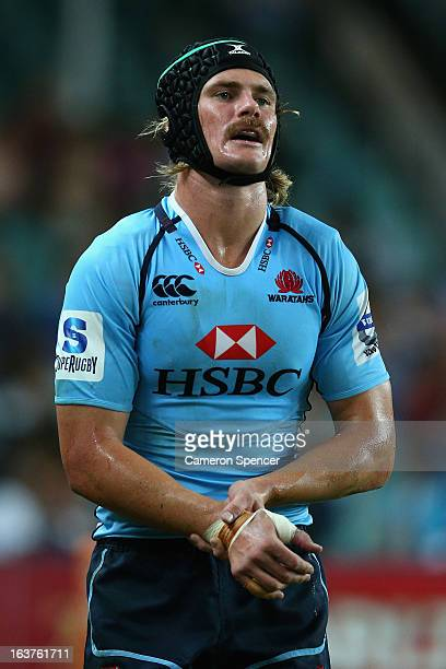 Berrick Barnes of the Waratahs leaves the field injured during the round five Super Rugby match between the Waratahs and the Cheetahs at Allianz...