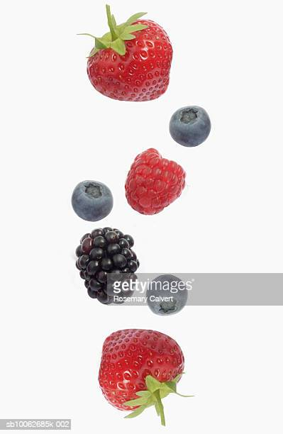 berries against white background, overhead view, close-up - blackberry fruit stock pictures, royalty-free photos & images