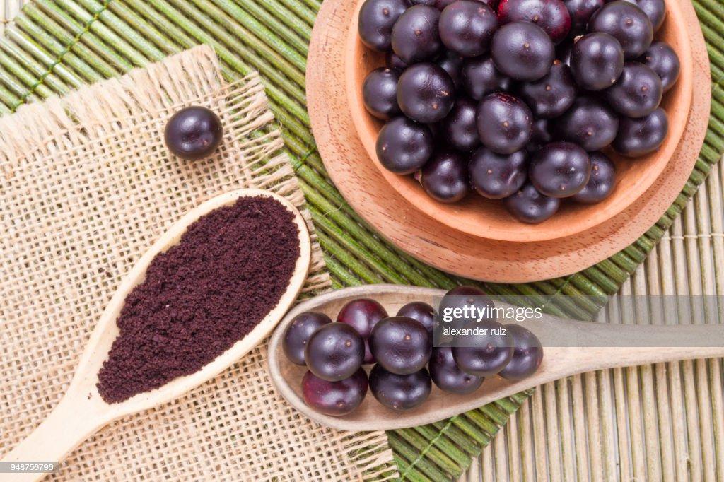 berries and acai powder : Stock Photo