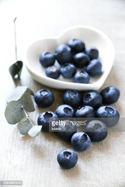 berries blueberries - lutavia stock pictures, royalty-free photos & images