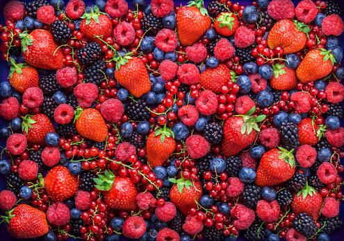 Berries overhead closeup assorted mix in studio on dark background 841659594