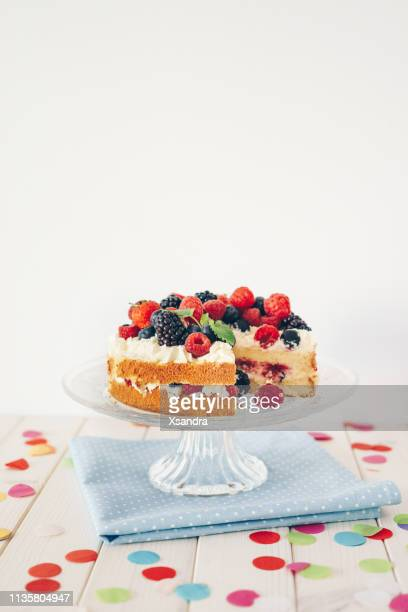 berry cake with colourful confetti - cake stock pictures, royalty-free photos & images